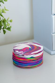 Learn how to use sculpey clay to make these bright tie-dye-inspired clay coasters.