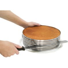 Easily create perfectly uniform multi-layered cakes with this 3 piece Frieling Stainless Steel Layer Cake Slicing Kit. This Cake Slicer Kit includes an adjustable mold, a knife and a large layer lifter. Cooking Gadgets, Cooking Tips, Cooking Ham, Keks Dessert, Cake Slicer, Do It Yourself Food, Baking Tools, Baking Pans, Baking Products
