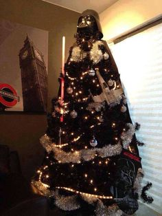 """""""I find your lack of cheer disturbing."""" EPIC Darth Vader Xmas tree! Happy Holidays from the Geek Girls!"""