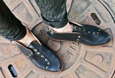 The ultimate cool shoe for spring. Studded leather black flats with a cut out in back. Designed in Spain, ethically made by artisans in Brazil.