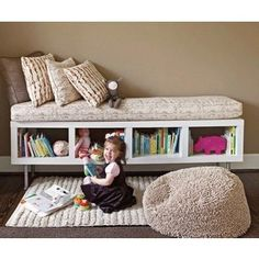 Ikea shelf. Storage & seating. Or....a cozy place to put the Princess Castle/Batman lair while playing.