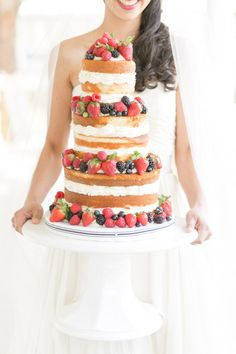 Naked cake detailed with berries: http://www.stylemepretty.com/southeast-weddings/2014/04/18/raspberry-striped-wedding-inspiration/ | Photography: Amalie Orrange - http://amalieorrangephotography.com/
