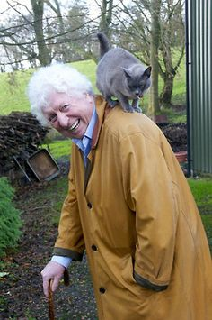 Tom Baker and a cat...all the more reason to love him!!