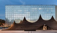 In conjunction with the 'Contemporary Morocco' exhibit at the Paris-based Institut du Monde Arabe, which was designed in 1987 by French architects Jean Nouvel and Architecture Studio, a tremendous traditional Moroccan tent has been constructed on the square in front of the building.
