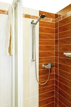Brown And White Tiled Shower With Chrome Showerhead