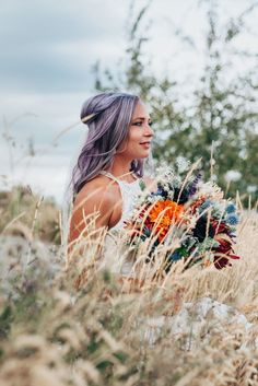 Beautiful bride with purple hair and high neck lace dress with purple and orange wedding flowers in this boho styled shoot by Kristi Alyse Photography in Northern Utah. logan utah wedding and family photographer boho wedding quality photography meaningful photography purple hair purple orange flowers bohemian wedding inspo bridal bouquet bride hair inspo #northernutahweddingphotographer #loganutahweddingphotographer #meaningfulphotography #bohowedding #weddingshoes #utahweddings…