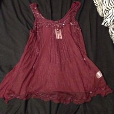 Vanity tank top Vanity tank top size small Maroon is the color very nice bead work never worn and NWT. Vanity Tops Tank Tops