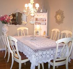 Simple Dining Table With White Fabric Table Cloth And White Mid Century Chair