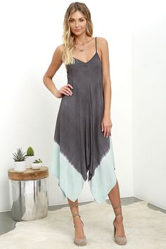 Jet off to your island retreat with the sun-ready Beach Bungalow Charcoal Grey Dip-Dye Midi Dress! Adjustable spaghetti straps support a gauzy triangle bodice that fades from charcoal grey to mint blue. Handkerchief skirt has a midi length.