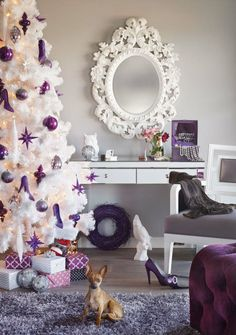 Create a more feminine Christmas tree this year with purple ornaments on the white Vegas tree.