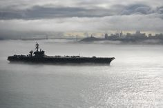 The Nimitz-class aircraft carrier USS Carl Vinson (CVN-70) departs San Francisco.