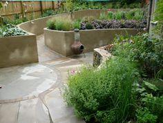 Ramped Garden Using Indian Stone By Paperbark Garden Design, UK.
