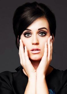 Check out the white eyeliner and bottom lash liner not following the eye. Makes eyes look ginormous!!!  Katy Perry.. love how 60's she looks
