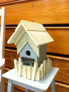 I liked the old hinge and used that to key the paint colors from and and the picket fence on this little birdhouse. Carla's Garden