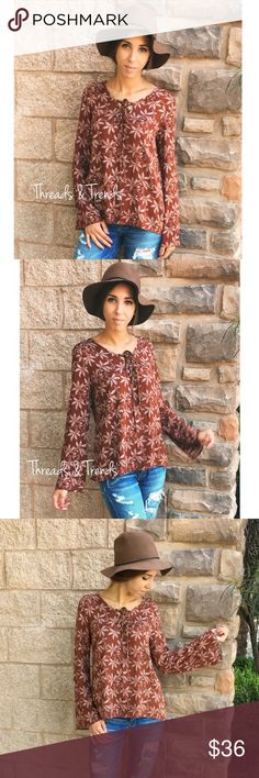 Bell Sleeve Lace Up  V-Neck Blouse BELL SLEEVE LACE UP V-NECK BLOUSE  PRODUCT DESCRIPTION  • long bell sleeves • v-neckline w/lace up detailing • leaf print all over • relaxed, easy fit • soft, breathable material  Material Content: Rayon Tops Blouses