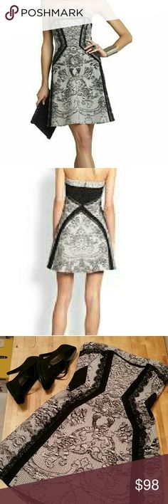 BCBG Sophiani strapless dress size S NWOT Strapless dress has a concealed back zipper with hook and eye closure. Lace print pattern with solid-trim and lace-trim detail. Measures approximately 26.75 inches from neck to hem. Straps not included but can be added. BCBGMaxAzria Dresses Strapless