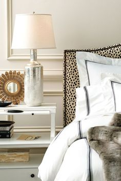 Classy and chic bedroom. Love the leopard headboard with hotel bed linens.*