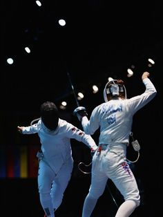 Hyojung Jung of Korea competes against Susie Scanlan of USA during the Women's Epee Team Fencing semifinal on Day 8 at ExCeL.