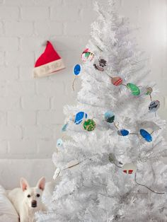 To add a sentimental touch to your tree, use a circle cutter to cut out pretty sections of past year's cards then attach them to twine with hot glue. Working on the garland can be a new holiday tradition, creating a decoration that will grow a bit longer each year as you add the previous year's cards. Get step-by-step instructions.