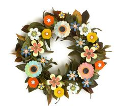 Adore! Handmade paper and felt flowers in a broad palette of spring and summer colors are secured to a wire wreath frame bedecked with green foliage tinged with browns, reds and golds...