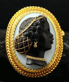 coisasdetere:  18th-century 18k gold and ebony cameo with diamonds depicting an African woman.