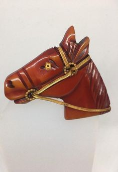 super horse head brooch carved in overdyed Bakelite and brass mane and reins. he has a glass eye. would look fabulous styled with wester wear. 2 x 2 excellent vintage condition, has a tiny chip on ear on the back. not visible when work. Horse Head, Carving, Brass, Brooch, Horses, Trending Outfits, Unique Jewelry, Handmade Gifts, How To Wear
