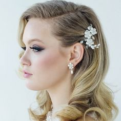 Flower Wedding Hair Comb with frosted Swarovski crystals a beautiful design for the bride or her bridesmaids. See more here: http://www.ayedoweddings.co.uk/evelina-hair-comb-awj/