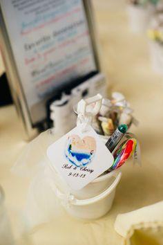 Children favors! Draw on the buckets with the marker. #weddingfavors #lollipops #saltwatertaffy #drawing #reception #weddingreception