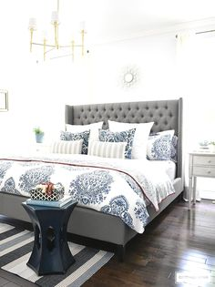 Blue and white Summer decorated bedroom with layers of bold pattern - batik stripes and paisley - bring a casual coastal look. Upholstered headboard with nailhead trim is classic and elegant. Light blue walls keep the look crisp and airy. - May 12 2019 at Coastal Master Bedroom, Coastal Bedrooms, Master Bedroom Design, Home Decor Bedroom, Bedroom Furniture, Bedroom Ideas, White Bedroom, Bedroom Designs, Diy Bedroom