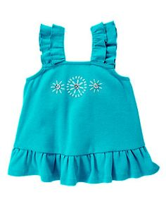 Gem Button Ruffle Top (size 3T) This bright ruffled top is embellished with sparkly gem buttons and embroidery. Ruffle straps and hem, 100% cotton rib.   Collection Name: Aqua Summer Color: Aqua Blue $18.95 On sale: $15.99