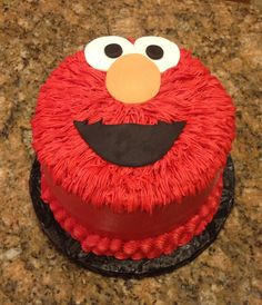 Elmo cake make with all buttercream with fondant nose and eyes