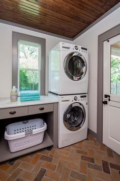 Beautiful laundry room marked by its stained plank vaulted ceiling, dutch door…