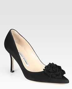 Pumps by Manolo Blahnik- I have red ones just like this...