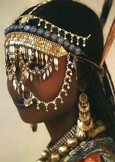 Afar women wear their jewelry both as a display of their wealth and as adornments of beauty, most notably on special occasions such as their wedding day.