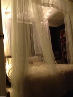 Bed canopy - diy using either curtain rods or towel racks mounted to the ceiling - ingenious !