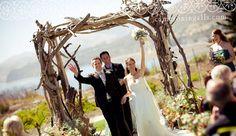 gorgeous wedding arch -- driftwood?