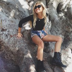 Cute destroyed shorts with black mid crop tops and black combat boots. Nice for school or out shopping