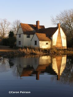 """Willy Lott's cottage at Flatford, Suffolk on a cold February morning.  This cottage was depicted in John Constable's famous painting """"The Haywain""""."""