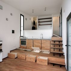 This is a 376 sq. ft. modern brick tiny home built on a hill in Alassio, Italy. This design/build is called Three Levels by Studioata. When you go inside, you'll find a unique layout with a l…