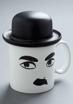 Hat's Entertainment Mug | This white porcelain mug boasts the famous features of the Little Tramp himself, including his iconic bowler made out of flexible silicone, ensuring your drink stays as surprisingly fresh as your fave silent film star's slapstick.