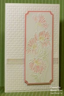 """By Bonnie Klass. Dry emboss a white panel using the """"Square Lattice"""" folder. Add ribbon. Attach to white card base. Color the flowers with marker on the """"Flower Garden"""" folder; then dry emboss on a white cardstock panel. You may want to color more after embossing. Use ticket punch on corners. Mat on solid color, also with punched corners. Pop up onto card."""