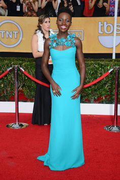 Lupita Nyong'o. Does she ever get it wrong? That color is fabulous on her! | Fashion At The 2014 SAG Awards Red Carpet