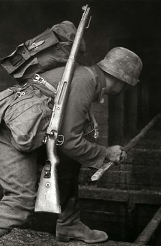 German soldier searching a house.
