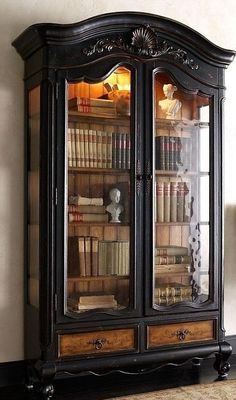black, carved armoir with glass doors