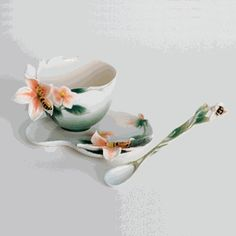Bee design sculptured porcelain cup/saucer set, and spoon
