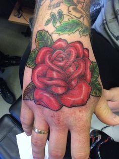 old school, hand tattoo, old school rose, red rose, rose on hand, men with tattoos
