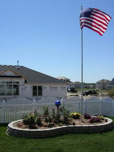 flag pole idea - small raised garden area around pole