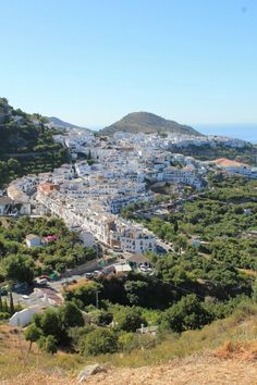 """Frigiliana is located 6 km north of Nerja, Mága, Here you can find the Jewish quarter """" Barrio Judio Mudejar """". Mujer is used to describe the architectural style used by Arabs craftsmen working in Christian territory. The Quarter is made up of steep cobbled alleyways with white houses surrounded with flowers."""