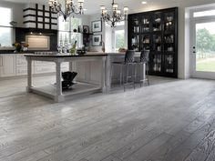 Preverco Hardwood Floors - Black-and-White Kitchen – A black-and-white kitchen design is always appealing and everlasting. In this classic version, everything blends, everything works all the way to the outstandingly eccentric Red Oak brushed texture, color Zebra wood floors. The texture and color of the floor brings a touch of originality to the more classic elements of the room.