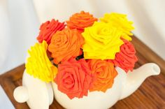 This bouquet is made for people who love spring/summer colors!  This item features 9 beautiful handmade short-stem paper flowers (3 of each: yellow, red, orange). Each flower has 1 leaf. Made from crepe paper, this flower bouquet is the perfect decoration for the holidays and can be used and/or combined with other items as a decoration for wall displays, weddings (e.g. bouquet, attached to tulle, church pews/aisles, tables), pictures, etc. The stems are also bendable to suit yo...